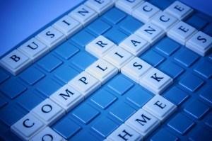 写真素材:word puzzle of COMPLIANCE and RISK